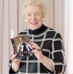 Steve holding a copy of her memoir, soon to be made into a film